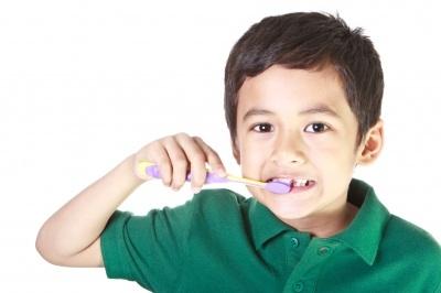 boy-brushing-teeth-By-Sura-Nualpradid